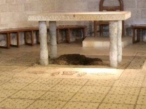 The altar in the Church of the Heptapegon, covering the rock on which Jesus blessed the loaves and fish.  Notice the mosaic of loaves and fish on the floor below.